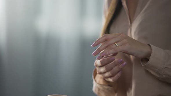 Thumbnail for Depressed Female Touching Her Finger with Gold Ring and Taking It Off, Break-Up