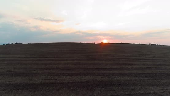Thumbnail for Agriculture Aerial View of Harvested Wheat Field at Sunset
