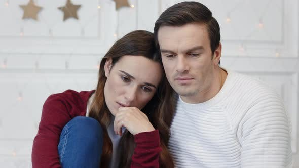 Thumbnail for Portrait of Thinking Couple Sitting in Living Room