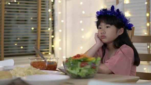 Little girl celebrating her birthday alone