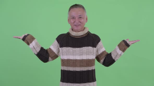 Thumbnail for Happy Mature Japanese Man Comparing Something