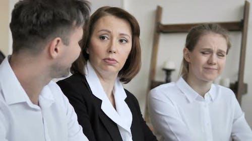 Businesswoman Talking with Teammates