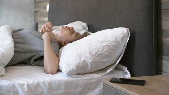 Thumbnail for Woman Waking Up and Using Phone in Bed