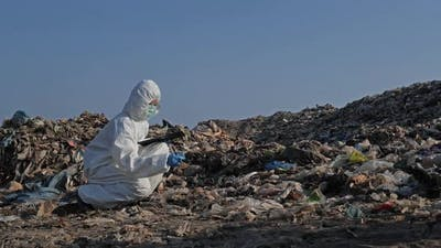 Scientist checking waste will be dumped at landfill site