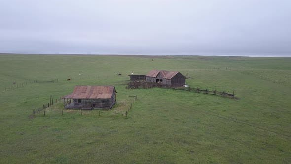 Drone Circling Abandoned Farmstead Homestead of Pioneer Settlers in Desolate Great Plains Prairie