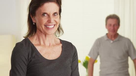 Thumbnail for Senior couple standing in living room smiling