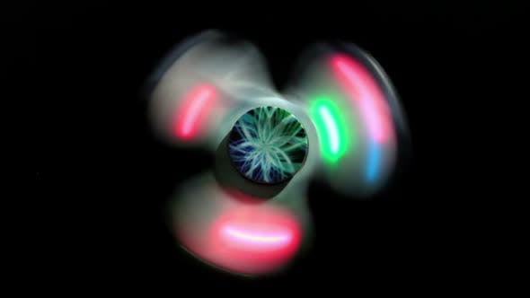 Thumbnail for Glowing Spinner Spins On A Black Background 1