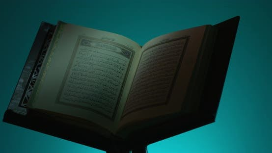 Cover Image for Holy Quran On Book Rest Rotation Partial Light