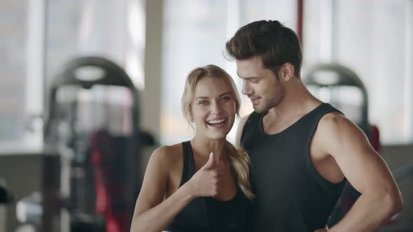 Thumbnail for Happy Couple Posing in Modern Gym