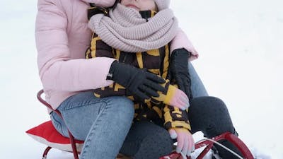 Woman with Child with Sleigh