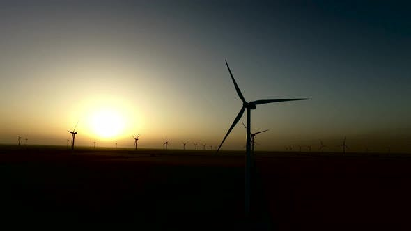 Thumbnail for Wind Turbines Regenerative Source of Energy in the Warm Glow of Sunset. Silhouette. Aerial Survey