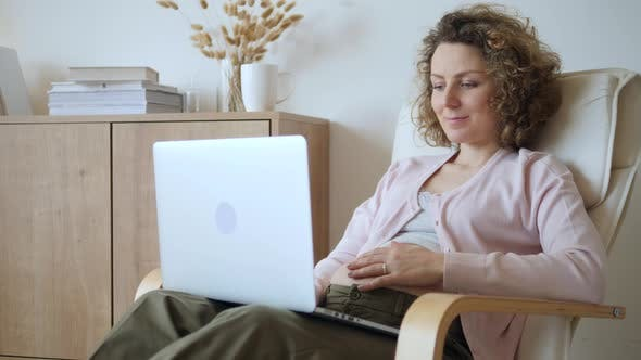 Pregnancy, People And Technology Concept. Pregnant Woman Working On Laptop.