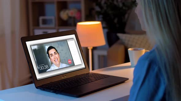 Thumbnail for Woman Having Video Call on Laptop at Home