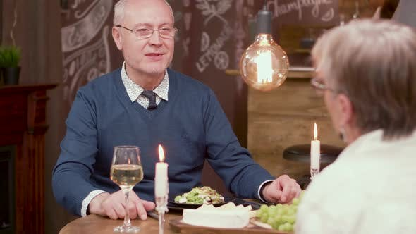 Old Man Making a Proposal To His Partner on a Romantic Dinner
