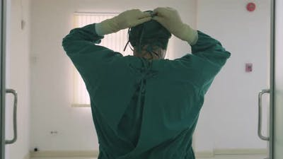 Male doctor walk into Hospital Operating Room.