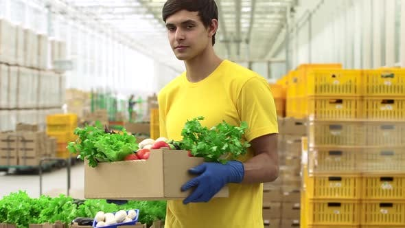 Box Food of Man is Holding in Warehouse of Organic Product for Retail Spbd