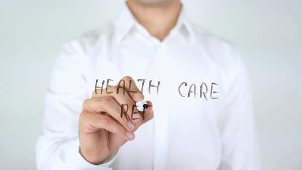 Health Care Reform, Man Writing on Glass