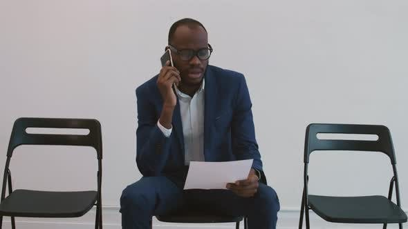 Thumbnail for African Businessman Talking on Mobile Phone