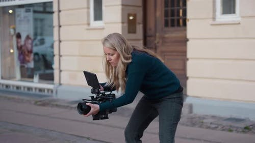 Female Film Maker Focusing Film Camera