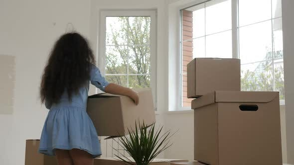 Thumbnail for Cheerful Family Carrying Boxes in Purchased House