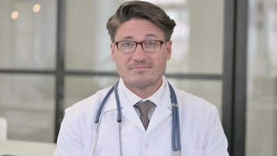 Portrait of Doctor Talking on Video Call