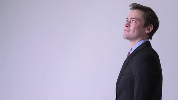 Thumbnail for Profile View of Young Happy Handsome Businessman