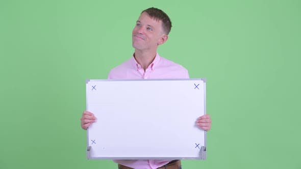 Thumbnail for Happy Businessman Thinking While Holding White Board