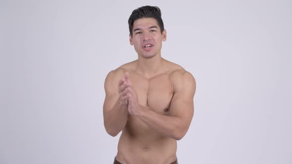 Thumbnail for Happy Young Handsome Muscular Shirtless Man Clapping Hands