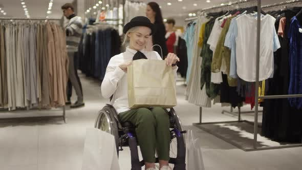 Thumbnail for Excited Woman in Wheelchair Posing in Clothing Store