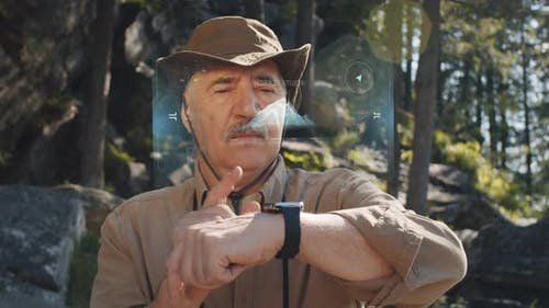 Senior Male Tourist Using Smartwatch with AR Interface
