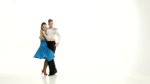 Thumbnail for Couple of Graceful Dancers Perform Tango on White Studio Background