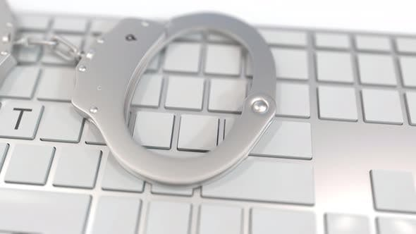 Thumbnail for Handcuffs on Keyboard with BOTNET Text on Keys