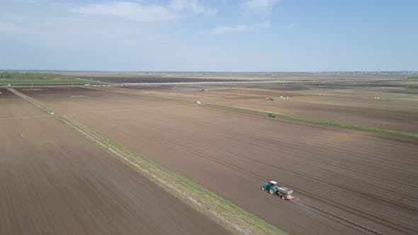 Cover Image for Tractor on Agricultural Lands Is Cultivated with Fertilizers