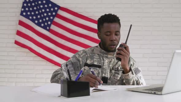 Thumbnail for Afro-american Soldier Using Computer and Portable Radio Set