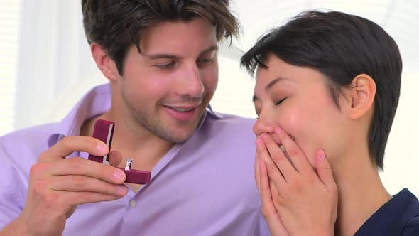 Thumbnail for Asian woman surprised by engagement ring