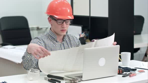 Thumbnail for Engineer Explaining Technical Drawing During Video Call Via Laptop