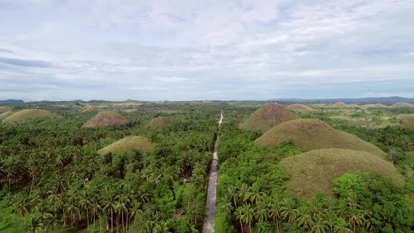 Thumbnail for Aerial view road crossing the Chocolate Hills Complex, Batuan, Philippines.