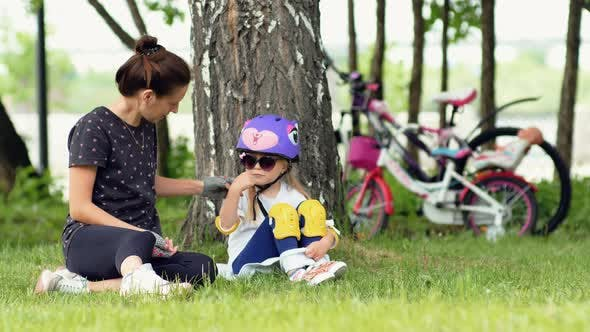 Mother And Daughter Enjoying Camping In Park