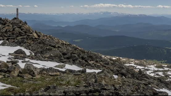 Thumbnail for Time Lapse of Cloudscape Behind of the Mountains Top. Snow, Rocks, Cliffs and Deep Blue Sky