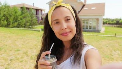 Woman With Lemonade Taking Selfie