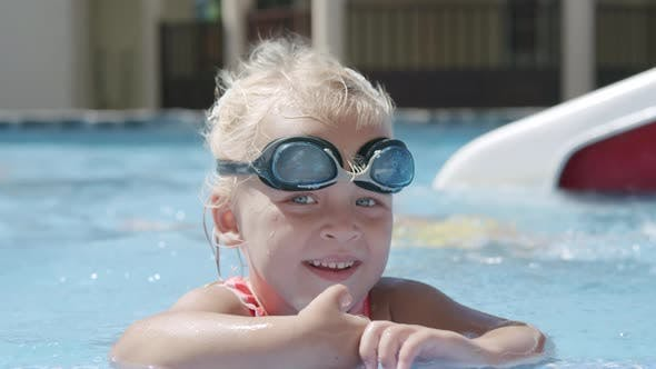 Thumbnail for Summer portrait of cheerful girl toddler in the pool