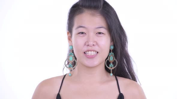 Thumbnail for Face of Happy Beautiful Asian Woman Talking Ready To Party