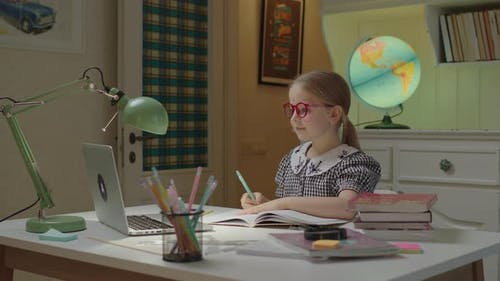 Schoolgirl Exited About Online Exam Passing During Online Education and Home Schooling
