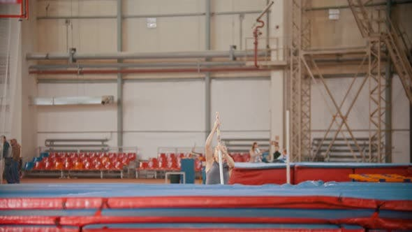 Thumbnail for Pole Vaulting - Beautiful Athlete Is Running and Jumping Over the Bar