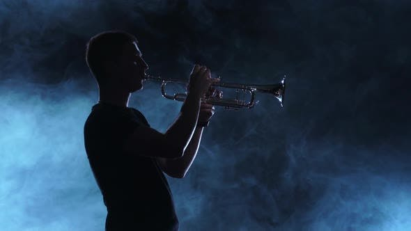 Thumbnail for Professional Musician Man Playing on Trumpet, Smoky Silhouette, Slow Motion