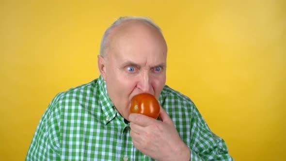Thumbnail for Hungry Elderly Man Enjoying Tomato