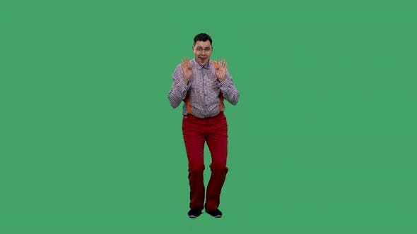Portrait of a Dancing Man on a Green Screen