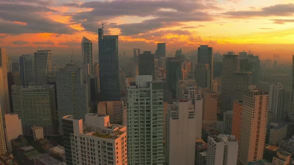 Cover Image for Sunrise in a Downtown View From High Above with Multiple Skyscrapers in Manila City, Philippines