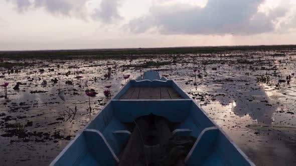 Thumbnail for Boat Sailing on the Marshland at Sunset