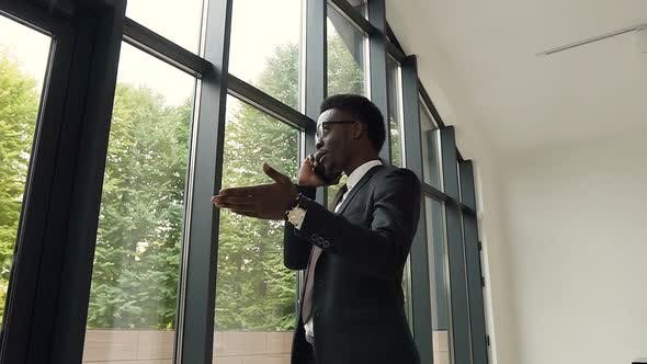 Thumbnail for Handsome afro american businessman talking on the smartphone